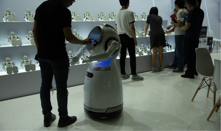 A man interacting with an interactive robot