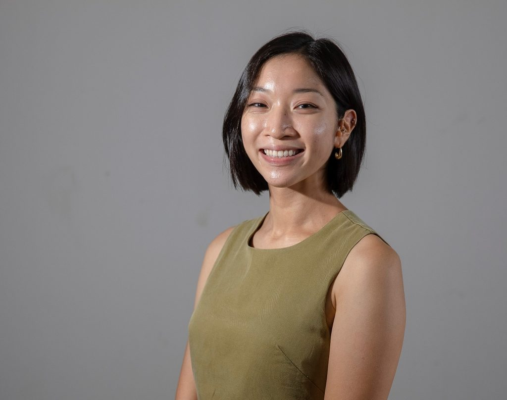 Picture of a girl in a khaki coloured top