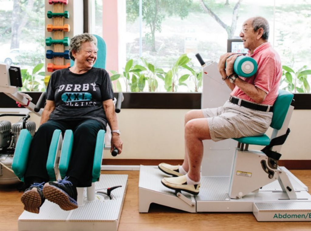 Two elderly people doing exercise