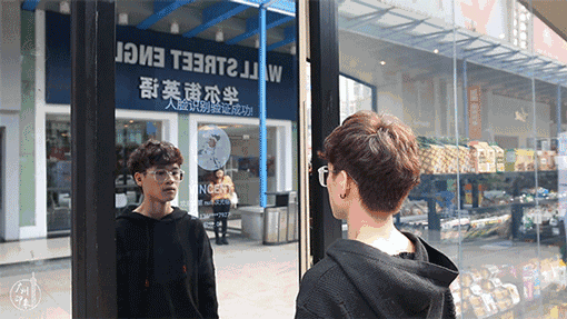 A man entering Comma Convenience Store by registering through facial recognition