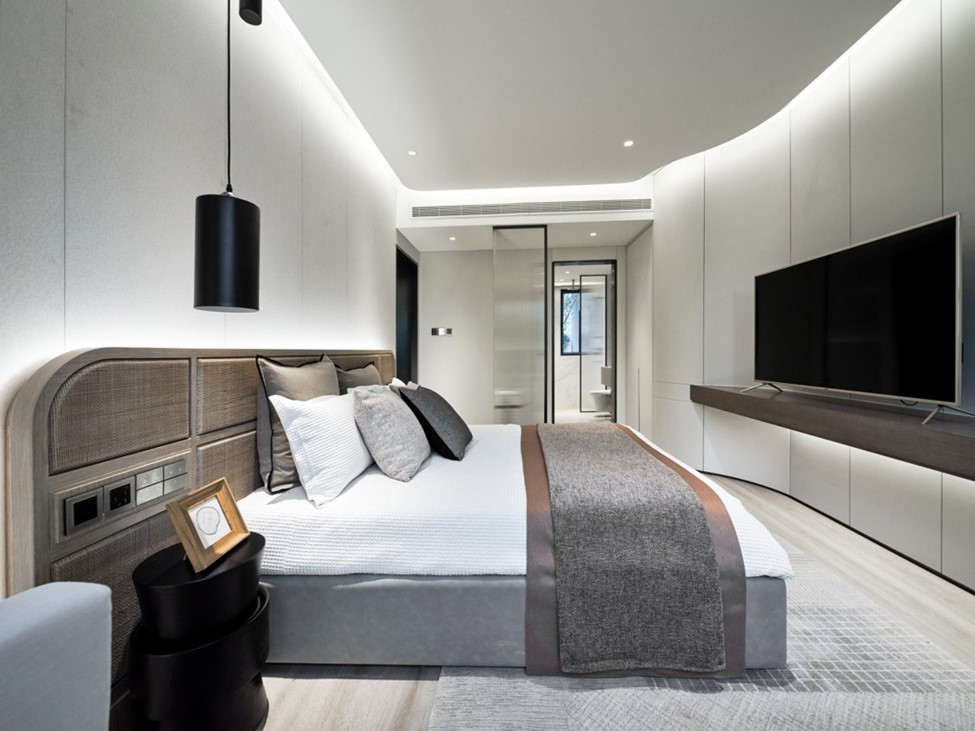 a bedroom with a television in a high-tech home